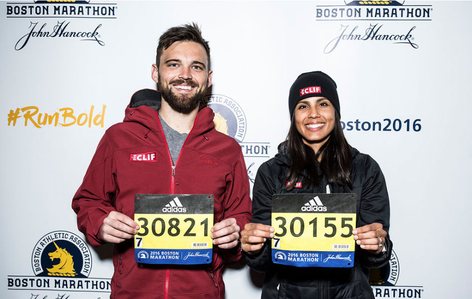 Two Boston Marathon runners with their race bibs